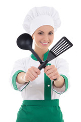 woman in chef uniform with kitchen tools isolated on white