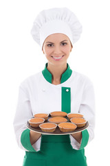 young chef woman in uniform showing tray with muffins isolated o