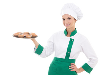 young chef or baker woman in uniform holding tray with muffins i
