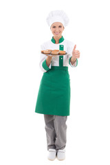 happy chef woman in uniform holding tray with muffins and thumbs