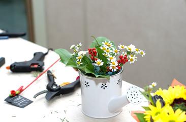 Florist tool on desktop composition of flowers