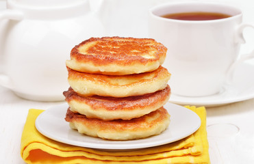 Curd pancakes stack and tea