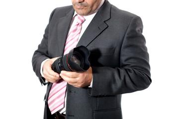 Fotografo professionista con obiettivo