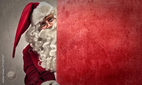 Leinwanddruck Bild Curious Santa Claus