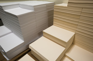 Stacks of white and beige paper