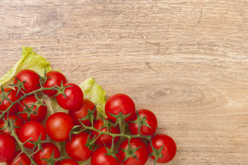 Red tomatoes on wooden board