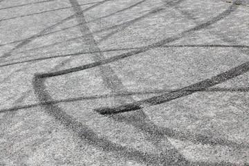 Skidmarks on the speedway. Transportation background.