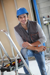 Young construction worker on site