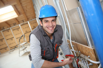 Plumber working in home being renovated