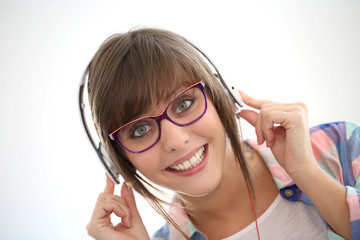 Portrait of cheerful girl with headphones on