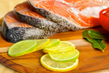 Delicious  portion of fresh salmon fillet with lemons and