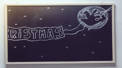 Time laps merry christmas blackboard