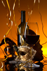 Venetian masks and red wine