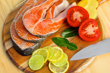Fresh salmon fillet with vegetables - healthy food concept