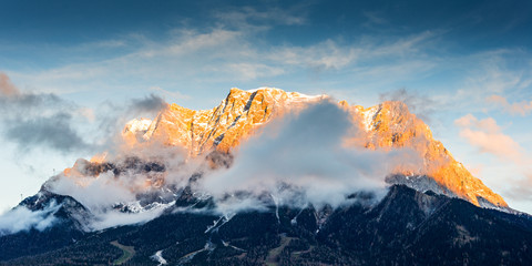 mountain chain wetterstein in tirol with lighted summit