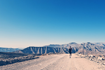 Shot of a Man Running on Mountain Road