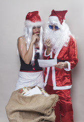 Beautiful girl and Santa Claus reading a Christmas letter 2