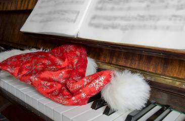 Santa Claus's cap on a piano