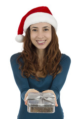 Christmas woman presenting a gift box, focus on the box