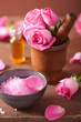 spa set with pink rose flowers mortar and herbal salt
