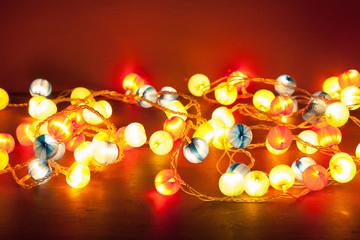 burning christmas lights over red background
