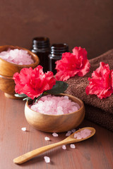 spa aromatherapy with azalea flowers and herbal salt on rustic d
