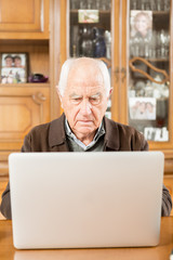 Senior working with Laptop, old man retired