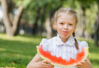 Kid with watermelon slice