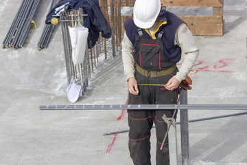 Worker working with armature