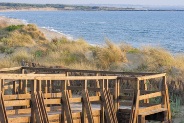 wooden panoramic bridge over the sand dunes of Tuscany