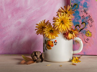 Yellow flowers in cup