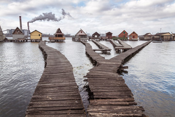 Bokod lake with piers and fishing huts, cloudy sky