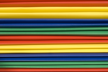 Close-up of Brightly Colored Plastic File Folder Spines