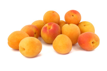 Some apricots isolated on white background