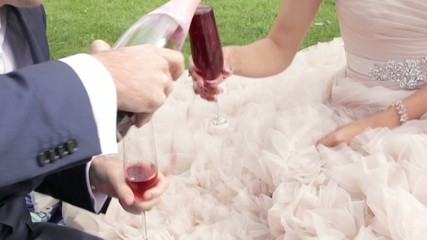 Pouring red wine on wedding dress