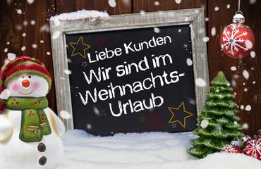 Weihnachtsdekoration mit Wir sind im Weihnachtsurlaub