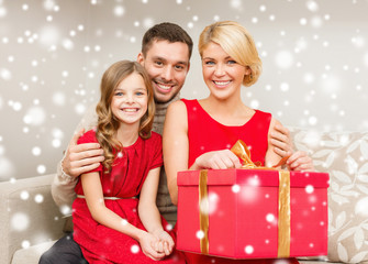 smiling family holding gift box