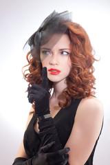 Portrait of beautiful girlretro style in black dress