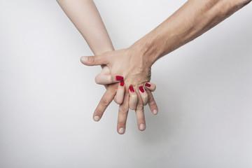 Woman's hand grasping man's hand
