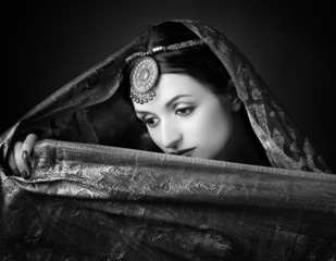 Beautiful brunette portrait with traditional costume