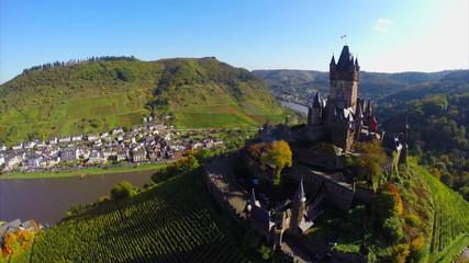 Old European castle vine hills, river aerial medieval fort above