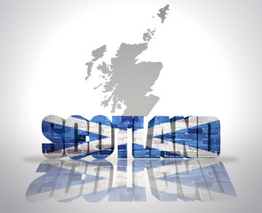 Word  Scotland on a map background