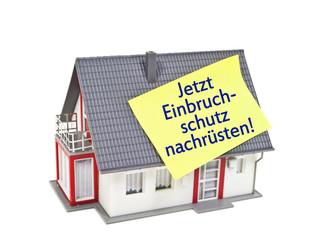 Haus mit Zettel und Einbruchschutz