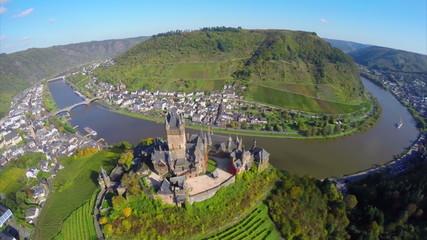 Flying above old century castle, small village river vine hills