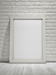 Wooden canvas frame on white brick wall background