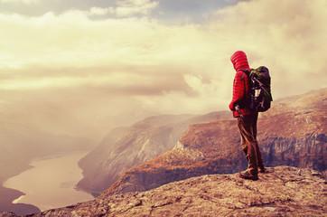 Man in mountains, Trolltunga , Norway