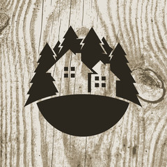 Vintage styled eco house badge with tree on wooden texture backg