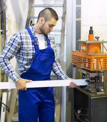 worker working on a machine