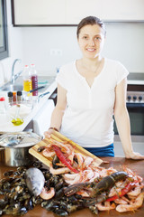 Happy woman cooking  with seafood