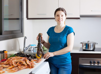 housewife cooking sea food specialties